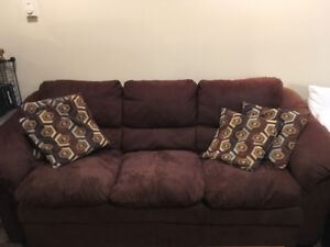 2 Full sized identical dark brown couches