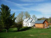 Farm houes on 8.5 acres ( = or-) plus out buildings