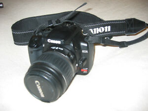 A Canon Rebel XTI  digital camera  by Canon
