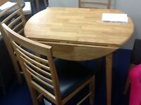 New dining table and 4 chairs, wood, drop leaf, extending to 3ft diameter round