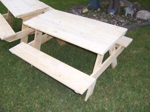 "Solid wood Kids picnic table measures about  36"" by 36"" by 22""."