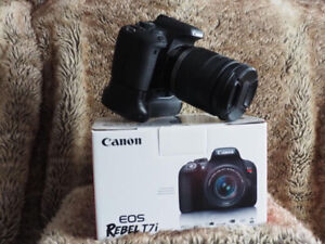 Canon T7i (800D), 18-200mm lens, battery grip, 2 batteries.