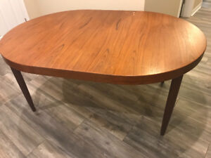 Solid Teak dining table seats 4-10