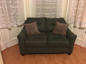 Charcoal grey couch and love seat set
