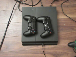 barely used ps4 with 2 controlers more than 10 games with it