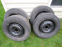 Set of 4 Goodyear Nordic Winter Tires on rims