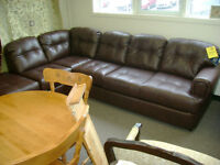 Brand new leather sectional by Serta. $1399.
