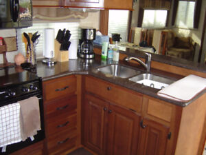 40-foot 2011 Cedar Creek Cottage 40CFL by Forest River for sale