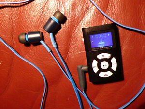 "MP3 Micro Player - Accepts up to 32GB microSD - 2""x 1 1/4"" x 1/2"