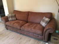 1 year old four seater sofa