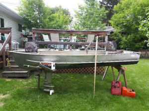 14 foot aluminum boat and 9.9 hp motor with gas tanks and seats