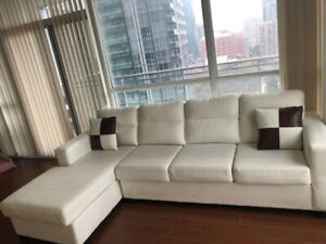 *******URGENT WHITE FAUX LEATHER SECTIONAL*********