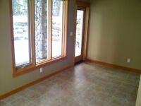 stylish 2 bd walkout suite available NOW in 3 sisters canmore