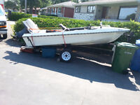small white motor boat with 50 horse power motor  negotiable