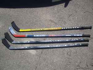 4 hockey sticks, hardly used,