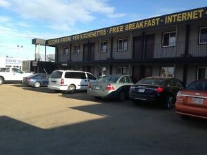 14 room motel with laundromat and pizza& icecream shop