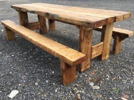 Handmade rustic table plus two benches.