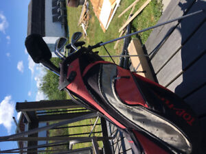 Left hand golf clubs and bag