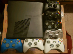 Xbox 360 system and 7 controllers