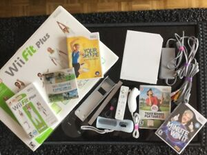 Nintendo Wii + planche Wii Fit, manette Wii , jeux - 130$