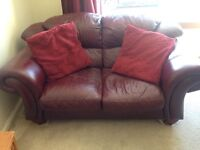 2 seater and 3 seater red leather sofas