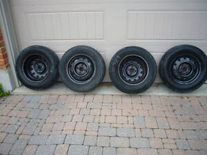 Snow tires on steel rims $400 London Ontario image 1