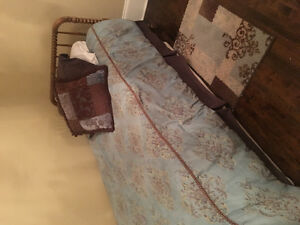 Set of antique twin beds with mattresses and box springs