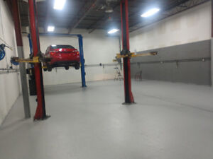 Autobody shop space available for mechanical work.
