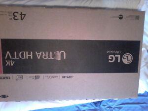 4K 43'' LG Ultra HD Smart Tv in factory packaging