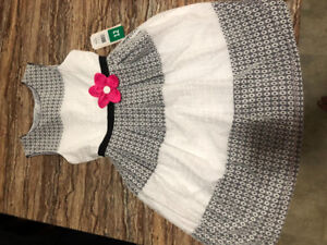 Beautiful white and black girls dress with pink accent flower