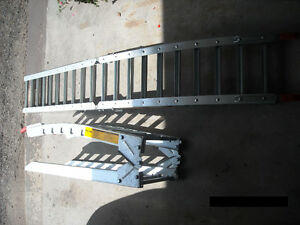 A pair of Steel, Prime Ramps for loading equipment in a truck.