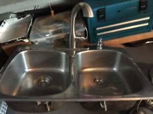 Double kitchen sink with faucet and soap dispenser