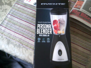 Personal Blender with Travel Lid. New in Box never open.