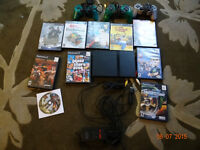 Play station 2 + games