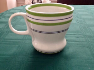 Starbuck Collectible mug White with green and blue stripes.