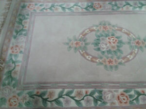 100% wool area rug in taupe