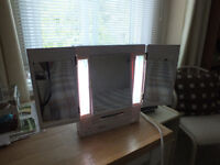 JERDAN VARIABLE SHADE LIGHTING & REFLECTION MAGNIFYING VANITY.