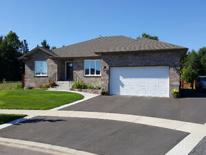 Newer 5 bed executive home on private greenspace/trails in town