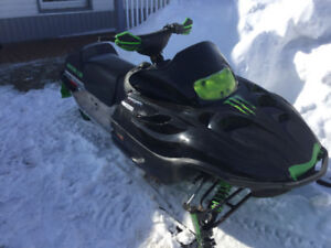 Two Arctic Cat Snowmobiles and trailer
