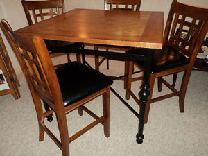 counter height table and six chairs