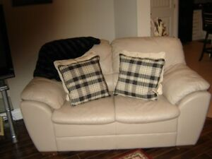 2 Beige Leather Loveseats with pillows