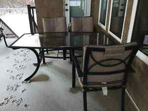 Solid glass and powder coated aluminum patio table and chairs