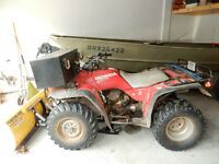 Honda Four Trax with plow