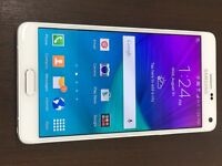 Samsung galaxy note 4 in white . 32 Gb unlocked . Condition is immaculate