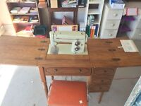 Kenmore sewing machine, cabinet and bench