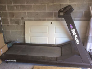 USED COMMERCIAL GYM TREADMILL 300$