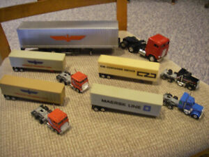 FIVE DIE-CAST SEMI TRUCKS WITH OCEAN CONTAINERS ON CHASIS