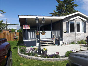 In clinton bc 2008 mobile with large addition on private lot
