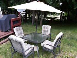 PATIO TABLE CHAIRS(4), CUSHIONS & UMBRELLA