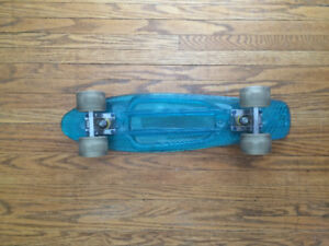 RB Blue Plastic Skateboard with White Sunset Flare LED Wheels